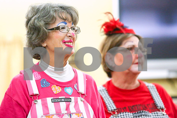 Cindy Rice (Rice Cakes) and Melinda Merrifield (Dazy Clown) listen during an event co-hosted by the Rosy Nose Clown Alley and Atria Senior Living Community at the Atria Copeland in Tyler, Texas, on Monday, Feb. 27, 2017. The event honored law enforcement from around the Tyler area. (Chelsea Purgahn/Tyler Morning Telegraph)