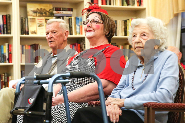 Truman Mizzles, left, Melinda Merrifield (Dazy Clown), center, and an Atria Copeland resident, right, during an event co-hosted by the Rosy Nose Clown Alley and Atria Senior Living Community at the Atria Copeland in Tyler, Texas, on Monday, Feb. 27, 2017. The event honored law enforcement from around the Tyler area. (Chelsea Purgahn/Tyler Morning Telegraph)