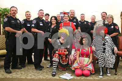 Law enforcement and Rosy Nose Clown Alley members pose for a picture during an event co-hosted by the Rosy Nose Clown Alley and Atria Senior Living Community at the Atria Copeland in Tyler, Texas, on Monday, Feb. 27, 2017. The event honored law enforcement from around the Tyler area. (Chelsea Purgahn/Tyler Morning Telegraph)