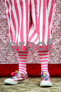 Cindy Rice (Rice Cakes) stands and listens during an event co-hosted by the Rosy Nose Clown Alley and Atria Senior Living Community at the Atria Copeland in Tyler, Texas, on Monday, Feb. 27, 2017. The event honored law enforcement from around the Tyler area. (Chelsea Purgahn/Tyler Morning Telegraph)