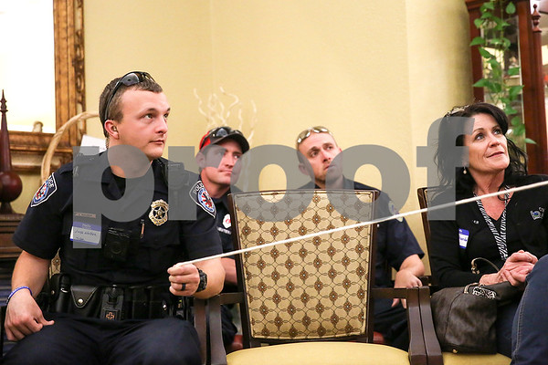 Tyler police officer Jake Walker, left, participates in a magic trick during an event co-hosted by the Rosy Nose Clown Alley and Atria Senior Living Community at the Atria Copeland in Tyler, Texas, on Monday, Feb. 27, 2017. The event honored law enforcement from around the Tyler area. (Chelsea Purgahn/Tyler Morning Telegraph)