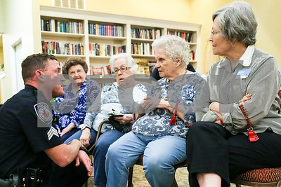 Tyler police unit sergeant Matt Leigeber speaks with Atria Copeland residents during an event co-hosted by the Rosy Nose Clown Alley and Atria Senior Living Community at the Atria Copeland in Tyler, Texas, on Monday, Feb. 27, 2017. The event honored law enforcement from around the Tyler area. (Chelsea Purgahn/Tyler Morning Telegraph)