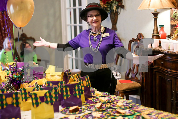 JoAnne McMeans, community liaison at Prestige Estates, speaks during a Mardi Gras celebration at Prestige Estates in Tyler, Texas, on Tuesday, Feb. 28, 2017. Stepping Stone School students paraded down the halls of the assisted living facility and handed out beads to the residents. (Chelsea Purgahn/Tyler Morning Telegraph)