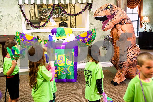 A Mardi Gras celebration at Prestige Estates in Tyler, Texas, on Tuesday, Feb. 28, 2017. Stepping Stone School students paraded down the halls of the assisted living facility and handed out beads to the residents. (Chelsea Purgahn/Tyler Morning Telegraph)