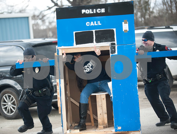 Grand Saline police officer Robyn Fedrick, rides the toilet seat as she's pushed by corporal Eric Doering, left, and sergeant Jason Burns, right, during the out house race during Buzzard Fest Saturday Feb. 6, 2016 in Grand Saline.  (Sarah A. Miller/Tyler Morning Telegraph)