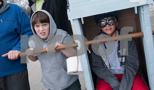 C.J. Russell, 11, waits to push his brother B.J. Russell Jr., 12, of Fruitvale, in the Van Zandt County Children's Shelter out house for the out house race during Buzzard Fest Saturday Feb. 6, 2016 in Grand Saline.  (Sarah A. Miller/Tyler Morning Telegraph)