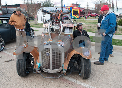 Reece Reeves of Weatherford, kneeling, shows off his hand built Munsters inspired rat rod during Buzzard Fest Saturday Feb. 6, 2016 in Grand Saline.  (Sarah A. Miller/Tyler Morning Telegraph)