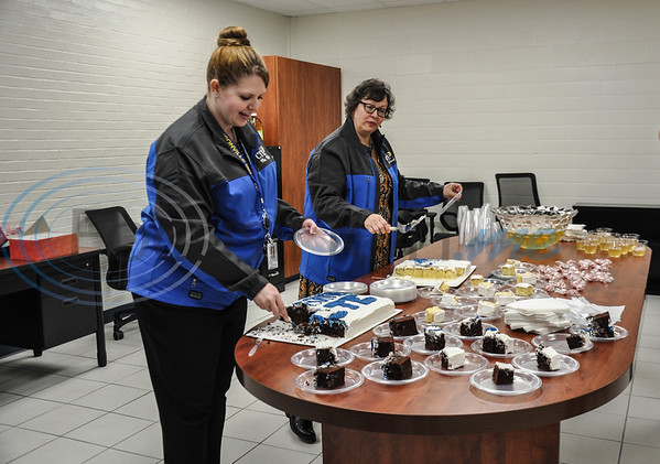 Jacksonville High School faculty Valerie Miller (left) and Glenda Stewart (right) pass out cake during the school's open house on Thursday, February 7. The Open House included a Ribbon Cutting and tour of the new building. (Jessica T. Payne/Tyler Morning Telegraph)