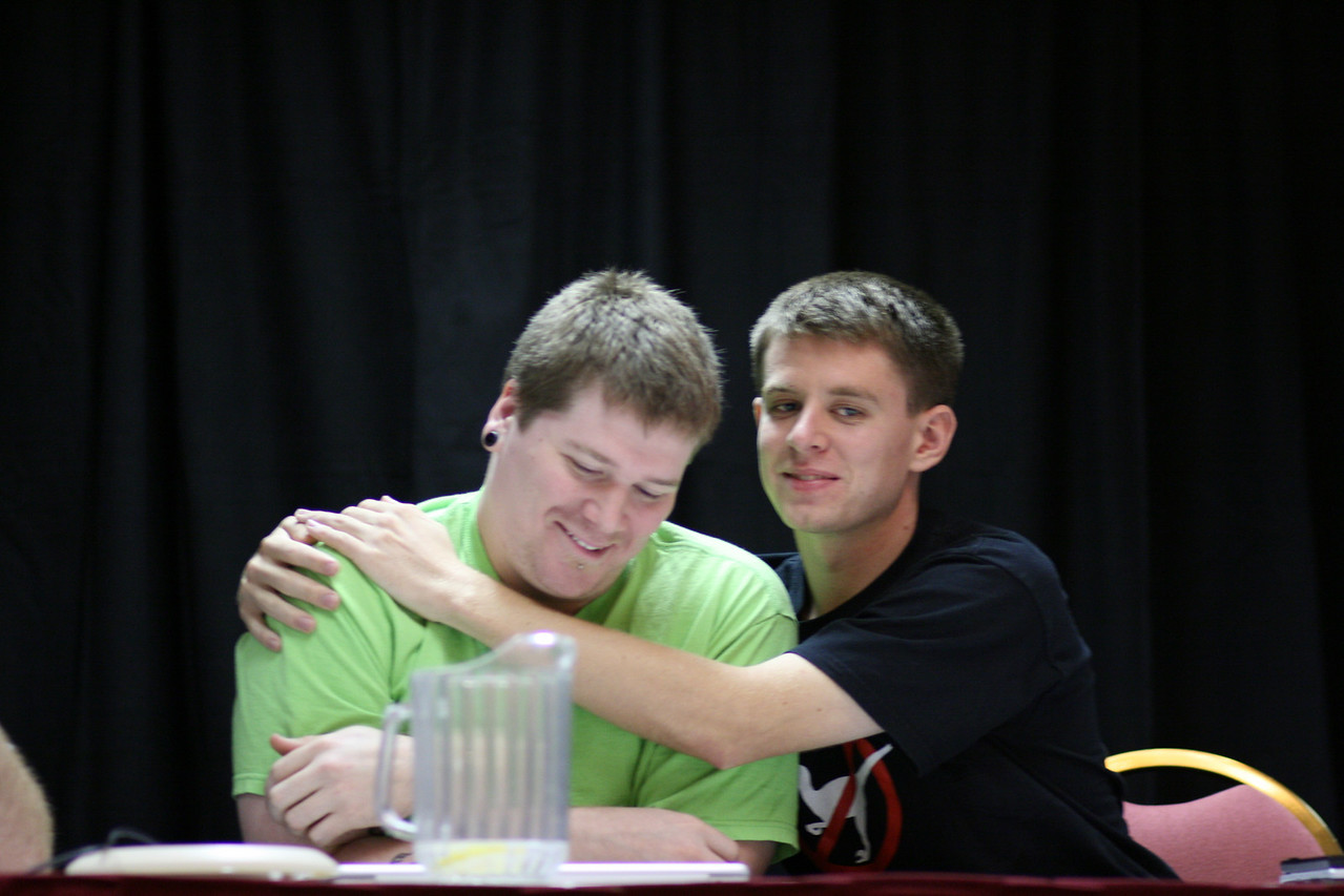 Jeph (Questionable Content) and Randy (xkcd) sharing a tender moment at the Webcomics panel.