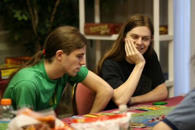 Lucky and Alan concentrating on playing Power Grid.