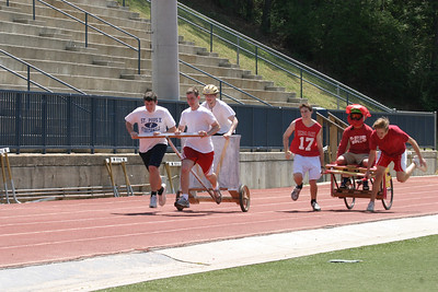 "In heat number one of the first ever chariot race at St. Pius X High School, Atlanta, about 40 yards from the finish line the red faction (""Chariot of Fire) was on the wheels of the white faction (""The Three Pale Ones"") until they had an unexpected spill"