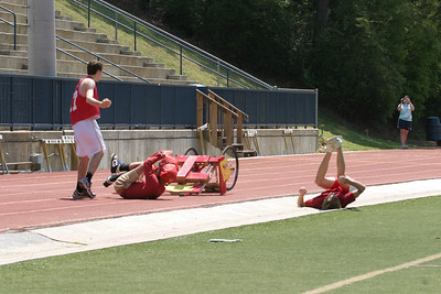 "In heat number one of the first ever chariot race at St. Pius X High School, Atlanta, about 40 yards from the finish line the red faction (""Chariot of Fire) was on the wheels of the white faction (""The Three Pale Ones"") until they had an unexpected spill."