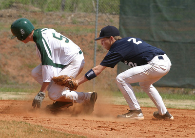 During the third inning of the first game of an april 10 doubleheader Pinecrest Academy catcher Jimmy Strom safely steals second base before Msgr. Donovan  High School second baseman second T. J. Krunkosky can apply the tag. The first game ended in a tie. Pinecrest won the second game 8-7.