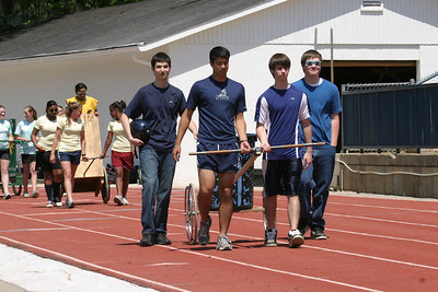 The blue faction participates in the chariot race procession at St. Pius X High School.