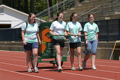 The green faction participates in the chariot race procession at St. Pius X High School.