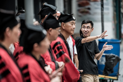 George Wan of HideandseeK Tours in Hong Kong helps educate visitors about the 30 Houses' Yulan Festival in SOHO on September 3, 2018.