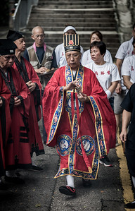 A Taoist priest takes part in a cleansing ceremony for the 30 Houses' Yulan Festival in SOHO on September 3, 2018.