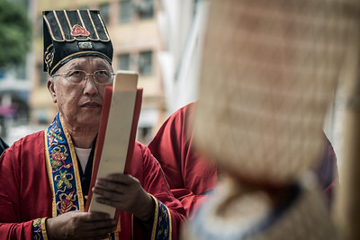 A Taoist priest recites a prayer for the 30 Houses' Yulan Festival in SOHO on September 3, 2018.