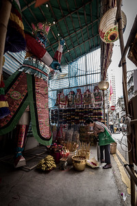 A local resident makes an offering to the Ghost King on display in the SOHO neighbourhood as part of the 30 Houses' Yulan Festival. September 3, 2018.