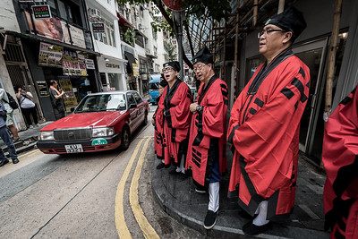 Taoist priests offer incantations amidst traffic at the 30 Houses' Yulan Festival in SOHO on September 3, 2018.