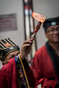 A Taoist priest offers prayers at the 30 Houses' Yulan Festival in SOHO on September 3, 2018.