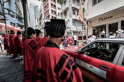 Taoist priests offer prayers and incantations amidst traffic at the 30 Houses' Yulan Festival in SOHO on September 3, 2018.