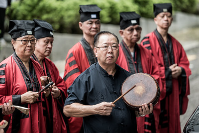 A man performs on the drums while Taoist priests chant at the 30 Houses' Yulan Festival in SOHO on September 3, 2018.