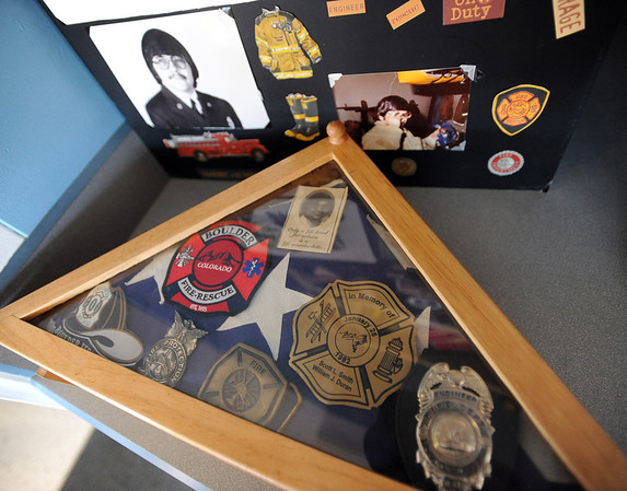 """Mementos of William Duran, displayed at the ceremony.<br /> It has been 30-years since William Duran and Scott Smith died in a fire training exercise in Boulder. Friends and family gathered at Station No. 3 in Boulder  to remember the sacrifice.<br /> For a video and photos from the ceremony, go to  <a href=""""http://www.dailycamera.com"""">http://www.dailycamera.com</a>.<br /> January 26, 2012 / Cliff Grassmick"""