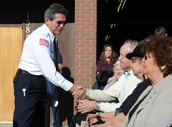 """Gil Espinoza of the City of Boulder Fire Rescue shakes the hands of Smith and Duran family members.<br /> It has been 30-years since William Duran and Scott Smith died in a fire training exercise in Boulder. Friends and family gathered at Station No. 3 in Boulder  to remember the sacrifice.<br /> For a video and photos from the ceremony, go to  <a href=""""http://www.dailycamera.com"""">http://www.dailycamera.com</a>.<br /> January 26, 2012 / Cliff Grassmick"""