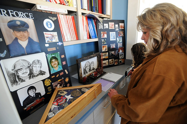 """Lucy Jiminez looks at the photo display for William Duran.<br /> It has been 30-years since William Duran and Scott Smith died in a fire training exercise in Boulder. Friends and family gathered at Station No. 3 in Boulder  to remember the sacrifice.<br /> For a video and photos from the ceremony, go to  <a href=""""http://www.dailycamera.com"""">http://www.dailycamera.com</a>.<br /> January 26, 2012 / Cliff Grassmick"""