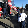 "Jay Ruggeri, left,  Tilio Lolotai and Dan Heisick, put up a flag on a fire truck before the service.<br /> It has been 30-years since William Duran and Scott Smith died in a fire training exercise in Boulder. Friends and family gathered at Station No. 3 in Boulder  to remember the sacrifice.<br /> For a video and photos from the ceremony, go to  <a href=""http://www.dailycamera.com"">http://www.dailycamera.com</a>.<br /> January 26, 2012 / Cliff Grassmick"