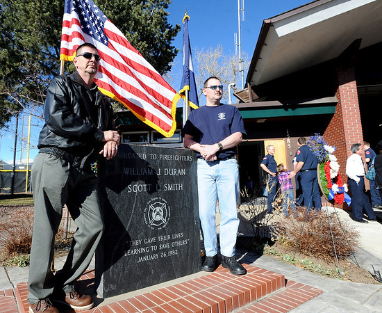 """Bill Duran, Jr, left, and brother Chris, pose for a family photo by the memorial made for their father, William and Scott Smith.<br /> It has been 30-years since William Duran and Scott Smith died in a fire training exercise in Boulder. Friends and family gathered at Station No. 3 in Boulder  to remember the sacrifice.<br /> For a video and photos from the ceremony, go to  <a href=""""http://www.dailycamera.com"""">http://www.dailycamera.com</a>.<br /> January 26, 2012 / Cliff Grassmick"""
