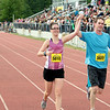 Record-Eagle/Keith King<br /> Jessica Roswell and Jason Gibson cross the finish line together during the 30th annual Bayshore Marathon half marathon Saturday, May 26, 2012 at Traverse City Central High School.
