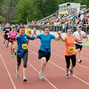 Record-Eagle/Keith King<br /> Runners cross the finish line during the 30th annual Bayshore Marathon Saturday, May 26, 2012 at Traverse City Central High School.