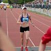 Record-Eagle/Keith King<br /> Caitlin Smith finishes first in the womens Bayshore Marathon Saturday, May 26, 2012 at Traverse City Central High School.
