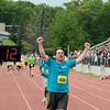 Record-Eagle/Keith King<br /> Steve Morgan raises his arms after finishing the 30th annual Bayshore Marathon half marathon Saturday, May 26, 2012 at Traverse City Central High School.