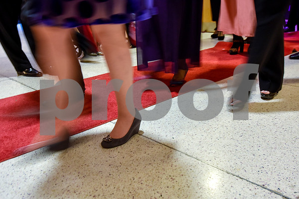 People walk the red carpet during Texas College's ninth annual Legacy Scholarship Fundraiser at Harvey Hall Convention Center in Tyler, Texas, on Friday, March 10, 2017. Five members of the community were honored for their commitment, dedication and service to Texas College and the City of Tyler. (Chelsea Purgahn/Tyler Morning Telegraph)