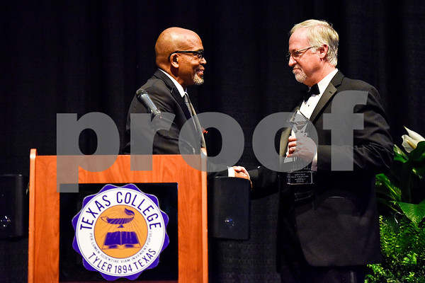 Mayor Martin Heines, right, receives an award during Texas College's ninth annual Legacy Scholarship Fundraiser at Harvey Hall Convention Center in Tyler, Texas, on Friday, March 10, 2017. Five members of the community were honored for their commitment, dedication and service to Texas College and the City of Tyler. (Chelsea Purgahn/Tyler Morning Telegraph)