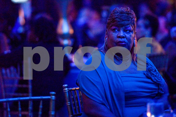 Katherine Watkins listens to Texas College's choir sing during Texas College's ninth annual Legacy Scholarship Fundraiser at Harvey Hall Convention Center in Tyler, Texas, on Friday, March 10, 2017. Five members of the community were honored for their commitment, dedication and service to Texas College and the City of Tyler. (Chelsea Purgahn/Tyler Morning Telegraph)