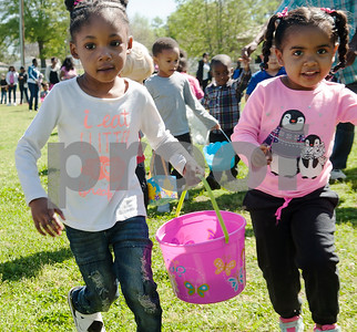 Two girls including Mariah Brown, 3, left, run to collect candy filled eggs at the 5th annual Easter egg hunt hosted by the JAABS Good Friday Committee at Emmett Scott Park in Tyler Friday March 25, 2016. Event organizer Ambra Phillips estimates that 1,000 children attended the event which included free food, bounce houses, faceprinting and music from local disc jockeys.   (Sarah A. Miller/Tyler Morning Telegraph)