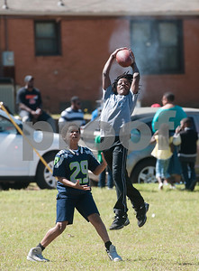 Dekari Wyatt, 11, makes a catch as he plays football with friends at the 5th annual Easter egg hunt hosted by the JAABS Good Friday Committee at Emmett Scott Park in Tyler Friday March 25, 2016. Event organizer Ambra Phillips estimates that 1,000 children attended the event which included free food, bounce houses, faceprinting and music from local disc jockeys.   (Sarah A. Miller/Tyler Morning Telegraph)
