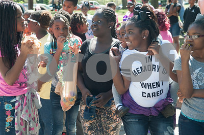 Children wait in line for lunch served by volunteers at the 5th annual Easter egg hunt hosted by the JAABS Good Friday Committee at Emmett Scott Park in Tyler Friday March 25, 2016. Event organizer Ambra Phillips estimates that 1,000 children attended the event which included free food, bounce houses, faceprinting and music from local disc jockeys.   (Sarah A. Miller/Tyler Morning Telegraph)