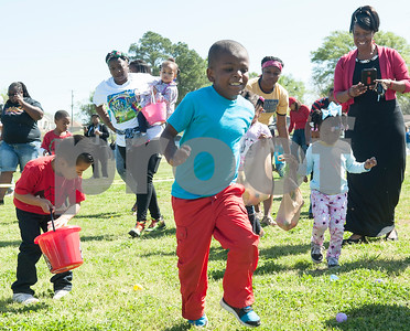 Children search for eggs at the 5th annual Easter egg hunt hosted by the JAABS Good Friday Committee at Emmett Scott Park in Tyler Friday March 25, 2016. Event organizer Ambra Phillips estimates that 1,000 children attended the event which included free food, bounce houses, faceprinting and music from local disc jockeys.   (Sarah A. Miller/Tyler Morning Telegraph)