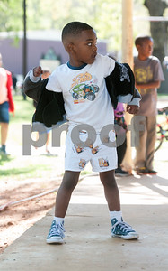 Lamar King, 5, dances to music at the 5th annual Easter egg hunt hosted by the JAABS Good Friday Committee at Emmett Scott Park in Tyler Friday March 25, 2016. Event organizer Ambra Phillips estimates that 1,000 children attended the event which included free food, bounce houses, faceprinting and music from local disc jockeys.   (Sarah A. Miller/Tyler Morning Telegraph)