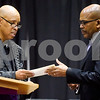 Spencer Hervey, president of the National Alumni and Ex-Student Association and trustee with the Board of Trustees, gives Texas College President Dr. Dwight J. Fennell a monetary gift from alumni during the Texas College Founders' Convocation at Texas College in Tyler, Texas, on Friday, March 16, 2018. The event celebrated 124 years of the college and featured special speakers and music performances. (Chelsea Purgahn/Tyler Morning Telegraph)