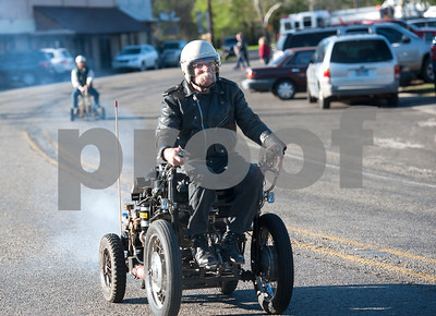 Bill Jenkins, 71, of Ben Wheeler, races his motorized barstool down Farm-to-Market Road 279 Saturday March 19, 2016 in Ben Wheeler, Texas. Six drivers participated in the quirky event. Vehicles had to function as a freestanding barstool with a minimum fixed seat height of 29 inches and a vehicle maximum width of 32.5 inches. The event was part of St. Patrick's Day celebrations.  (Sarah A. Miller/Tyler Morning Telegraph)