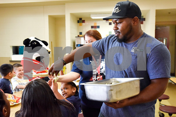 J'Colby Darden, director of the after school program at the Salvation Army, hands out condiments to children as they eat dinner at the Salvation Army in Tyler, Texas, on Monday, March 20, 2017. The Chick-fil-A locations on Broadway Avenue and Troup Highway worked together on a soup drive and raised a total of 5,116 bowls of soup to donate to the Salvation Army. (Chelsea Purgahn/Tyler Morning Telegraph)