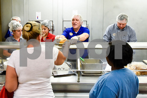 Jeff Johnston, owner and operator of the Broadway Crossing Chick-fil-A, serves people dinner at the Salvation Army in Tyler, Texas, on Monday, March 20, 2017. The Chick-fil-A locations on Broadway Avenue and Troup Highway worked together on a soup drive and raised a total of 5,116 bowls of soup to donate to the Salvation Army. (Chelsea Purgahn/Tyler Morning Telegraph)