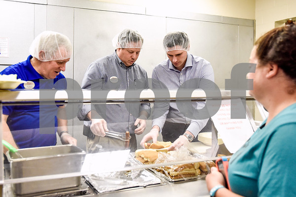 Jeff Johnston, Michael Chastain and Ikey Eason prepare meals for dinner at the Salvation Army in Tyler, Texas, on Monday, March 20, 2017. The Chick-fil-A locations on Broadway Avenue and Troup Highway worked together on a soup drive and raised a total of 5,116 bowls of soup to donate to the Salvation Army. (Chelsea Purgahn/Tyler Morning Telegraph)