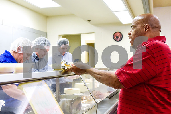 Wesley Moore Jr. is served dinner at the Salvation Army in Tyler, Texas, on Monday, March 20, 2017. The Chick-fil-A locations on Broadway Avenue and Troup Highway worked together on a soup drive and raised a total of 5,116 bowls of soup to donate to the Salvation Army. (Chelsea Purgahn/Tyler Morning Telegraph)